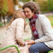 Romantic couple in a park, having a date — Stock Photo #12018723