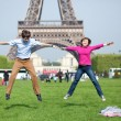 Happy young couple jumping near the Eiffel Tower — Stock Photo #12019305
