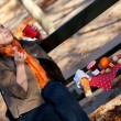 Beautiful young girl drinking hot tea in park at fall — Stock Photo