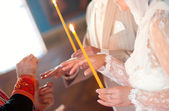 Priest putting ring on bride — Stock Photo