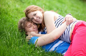 Young happy couple having fun together in park — Stock Photo