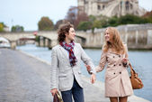 Romantic couple in Paris at the embankment — Stock Photo