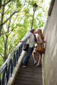 Romantic couple in Paris, kissing at the stairs — Stock Photo