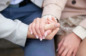 Couple having a date, holding each others hands — Stock Photo
