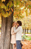Romantic couple dating at fall — Stock Photo