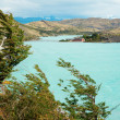 Stock Photo: Scenic view of Pehoe lake and Pehoe hostel in Torres del Paine n