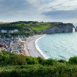 Stock Photo: Scenic view of Etretat town with its beach and famous cliffs wit