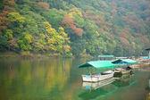 Boats on Katsura river at fall in Arashiyama, Kyoto, Japan — Stock Photo