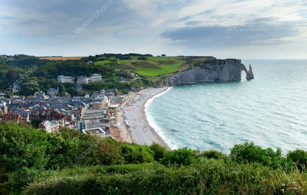 Фотообои Scenic view of Etretat town with its beach and famous cliffs wit