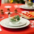 Decorated Christmas dining table with delicious salad (spinach, - Foto de Stock  