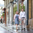 Dating couple walking in Paris after the rain — Stock Photo