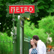 Beautiful couple is kissing near the metro station in Paris — Stock Photo #12843866