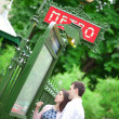 Beautiful couple is looking at the metro plan — Stock Photo