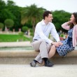 Romantic couple sitting by the water in Luxembourg garden of Par — Stock Photo #12843995
