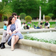 Loving couple sitting by the water in Luxembourg garden of Paris — Stock Photo