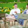 Laughing couple sitting on chairs in Luxembourg garden of Paris — Stock Photo #12844096