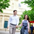 Happy positive couple walking in Paris near a street cafe — Stock Photo #12844253