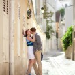 Romantic couple kissing on a street of Montmartre in Paris — Stock Photo #12844467