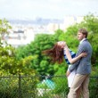 Sensual couple is hugging tenderly on Montmartre with nice view — Foto de Stock