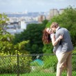 Happy laughing couple is hugging on Montmartre — Stock Photo