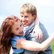 Happy positive romantic loving couple is hugging and laughing — Stock Photo