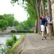 Happy couple is dancing on the Seine embankment in Paris — Stock Photo