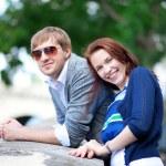 Happy smiling couple having fun outdoors — Stock Photo