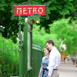 Beautiful couple is hugging near the metro station in Paris - Stock Photo