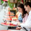 Couple in a Parisian outdoor cafe — Stock Photo