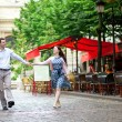 Royalty-Free Stock Photo: Couple walking in Paris near an outdoor cafe