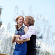 Young loving couple in Paris kissing near the fountain — Stock Photo #12845335