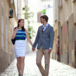 Romantic couple walking on a street of Montmartre in Paris — Stock Photo