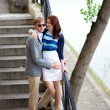 Romantic couple on the stairs at the Seine embankment — Stock Photo #12848060