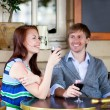 Beautiful couple enjoying their red wine in a cafe — Stock Photo #12848086