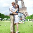 Closeup of happy positive couple hugging near the Eiffel tower — Stock Photo