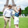 Closeup of happy positive couple dancing near the Eiffel tower — Stock Photo
