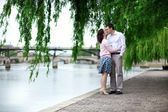 Romantic dating couple is kissing under the willow — Stock Photo