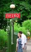Beautiful couple is kissing near the metro station in Paris — ストック写真