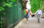 Cheerful dating couple is walking in Paris — Stock Photo