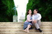 Couple sitting on the stairs in park — Stock Photo
