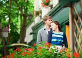 Man and woman together on balconyof their house or hotel with bl — Stock Photo
