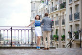 Beautiful couple at viewpoint on Montmartre in Paris — Stock Photo
