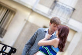 Beautiful romantic couple talking and hugging on the street — Stock Photo