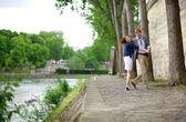 Happy couple is dancing on the Seine embankment in Paris — Stock Photo