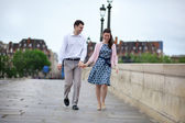 Dating couple in Paris walking hand in hand — Stock Photo