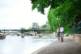 Romantic dating couple is walking by the water — Stock Photo