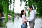Romantic dating couple in a Parisian park — Stock Photo