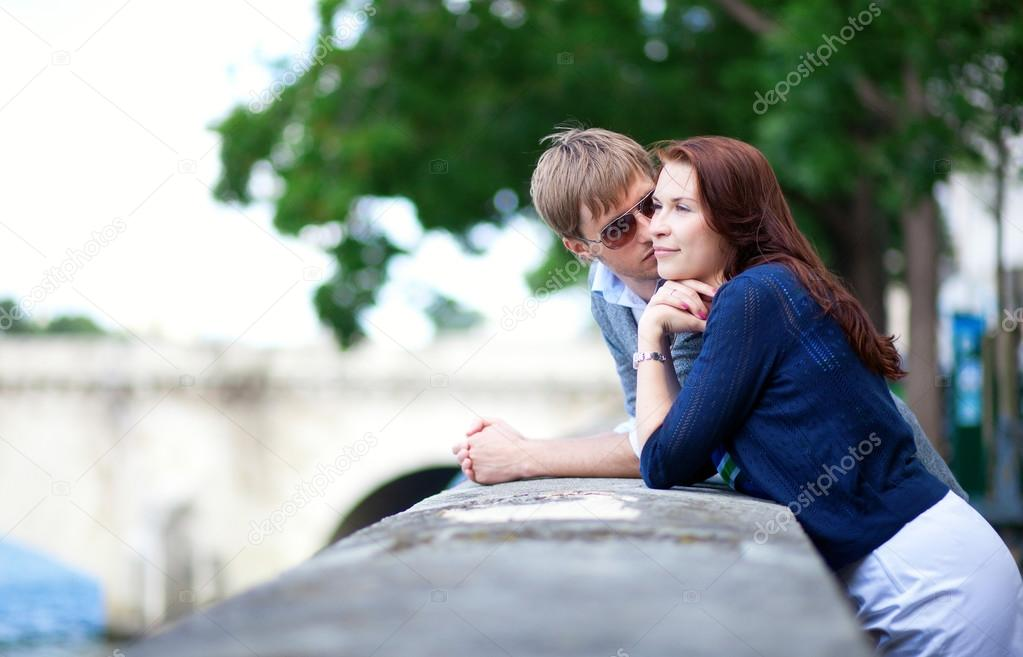 Romantic couple is talking at the Seine embankment in Paris  Stock Photo #12844895
