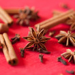 Variation of Christmas spices - star anise, cinnamon sticks and - Stock Photo