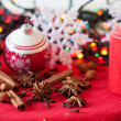 Variation of spices, Christmas decorations and a candle — Stock Photo
